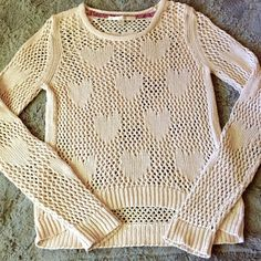 HP! LC Lauren Conrad Knit Heart Sweater  Great condition, no signs of wear or damage.   Thick, open knit sweater. Tag says 100% cotton.   Size M, but runs a bit small. I usually wear a size S and this fits me pretty well.   Offers are welcome  LC Lauren Conrad Sweaters Crew & Scoop Necks
