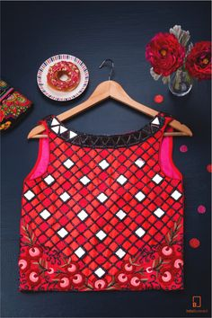 A red tank that is custom designed with diamond shaped mirrors. It has a breezy back to add that oomph. Pair it with those boyfriend jeans or leather pants! #indianfashion #indianoutfits #custommade #designdevelopdeliver #buycustom #indiaboulevard #streetstyle #summer2016
