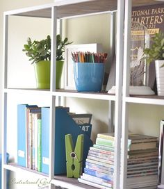 #ikea VITTSJÖ shelving unit: painted white, glass shelves replaced with dark wood ones