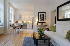 Small Apartment. Shot gun floor plan pulled together with gallons of white paint & fabric.