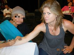 Tracy Burnham of BABYWORLDONLINE.NET, which delivers everything BUT the baby, getting a henna tattoo from someone with KD's Threading + Beauty Spot in San Mateo.