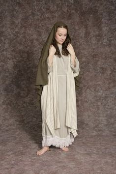 $20.00 Nativity Woman #3 grayish white dress w/white fringe, cream striped long vest & sash, olive headpiece