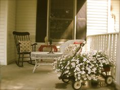 A wagon full of petunias on the porch