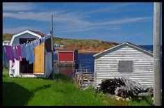 This photo from Newfoundland, Atlantic is titled 'Childhood Memories'. Newfoundland Canada, Newfoundland And Labrador, Colourful Buildings, Island Tour, Collage Ideas, Beautiful Places In The World, Fishing Villages, Clothes Line, Nova Scotia