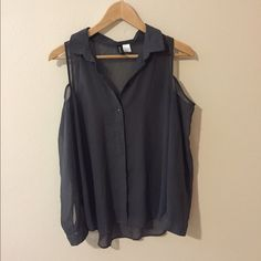 H&M top Sheer but durable material with cut out shoulders. Very cute! :) Size 2 but loose fitting. Bought at H&M. Great condition. Divided Tops Button Down Shirts