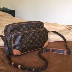 authentic Louis Vuitton Nile crossbody Good condition has sign of use too Louis Vuitton Bags Crossbody Bags