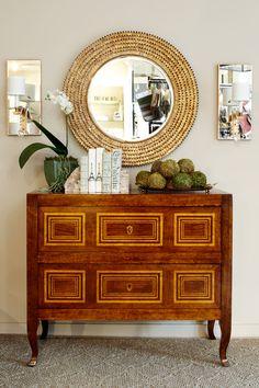 antique chest, gold details, round mirror, sconces, styling