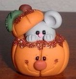 Little mouse in a pumpkin, made of polymer clay.  Artist unk.