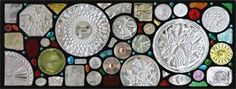 FOUND OBJECT WINDOW : This is another of the found object windows that became a narrative of the client and her family. It also includes gardening, food, patriotic images and some rocking fun textured glass.