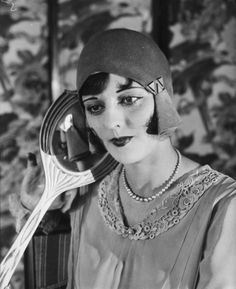 1930's hat--and she has the perfect face for it.