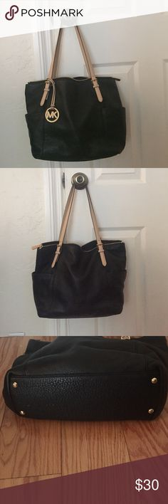 "Michael Kor's Black Handbag Michael Kors Black Handbag with Tan Straps; 2 Large side pockets; Measurements Width 15.5"" Height 11"" Depth 6"" Strap Drop 9"" ; Strap with stitching undone about 4"" length pic above shows the area Michael Kors Bags Shoulder Bags"