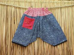 Lightweight hippie style cotton trousers / pants in ethnic Hmong batik. The drop crotch style gives little ones ease of movement.  One of a kind bohemian