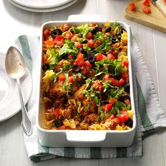 Taco Noodle Casserole Dish Recipe -I got creative while we were housebound during a snowstorm one winter...and used ingredients I had on hand to come up with this hearty casserole. Later, I modified it so it has less fat and fewer calories. —Judy Munger, Warren, Minnesota