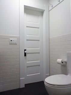 """Love the wainscoting-style subway tile plus black (vs. white) floor is the way to go... White floors require constant """"broom"""" vigilance. :)"""