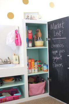 Amara's incredible play space with a gorgeous DIY kitchen and gold polka dot decals, love & lion