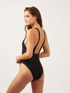 3c020d2c92 Delicate ribbed texture adds dimension to this effortlessly chic one-piece.  High boat neck