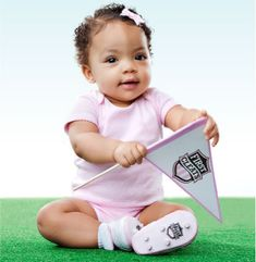 First Cleats for HER    The Crowd goes wild for  her first cleats!    These soft, safe and fun  baby cleats are sure to get your  little rookie off to a winning start.    One size, 0-6 months.    $24.95