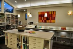 Learn from a kitchen layout. An island in an art studio or craft room can function much like it does in a kitchen. It provides an extra work surface, drawers for tools and even flat files and/or slots for stained glass. Its location in the center of everything improves efficiency.