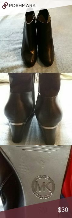 MICHAEL Michael Kors Wedge Bootie MICHAEL Michael Kors black leather wedge heel bootie with black elastic at the back and zips on the sides 3 inch heel. Minor wear and a few small scratches otherwise good condition size 8M MICHAEL Michael Kors Shoes Wedges