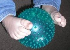 Ball pass is a fun game where children only use their feet. Using differently textured balls makes it a great sensory activity as well. Check out the #YIMS Yoga Games Page for more fun #kidsyoga games http://bit.ly/bTapo6