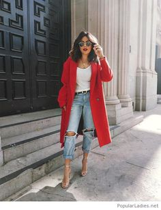 White top, jeans and red coat