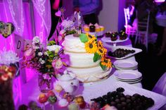 Sunflower wedding cake and dessert bar