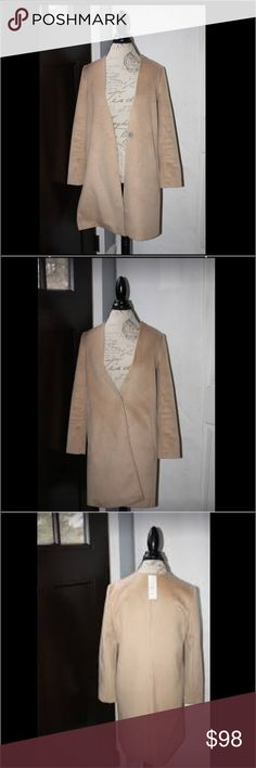 Camel hair jacket bonded to grey jersey interior Amazing material this is a vendor  jacket used as a sample only. Tags with retail price attached. Cannot list vendor as they are still selling this jacket. Beautifully made❗️not reversible. Inside pic is to show quality. vendor sample cannot list name Jackets & Coats