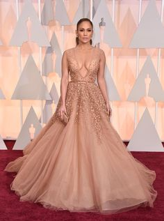 Jennifer Lopez may not be nominated for an Oscar, but that didn't stop the singer and actress from stealing the show in a revealing nude dress by Elie Saab. The 45-year-old star made sure she was dressed for the occasion before taking to the stage to present an award on Feb. 22, 2015.