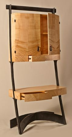 Contemporary Secretary - Rob Hare. I saw his w Orkney @ Phila Furn show. Very nice combination of graceful wrought iron & wood joinery