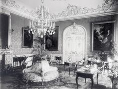 Highclere Castle, owned by the same Lord Carnarvon who financed the King Tut expedition, is the location for the shooting of Downton Abbey. This is a period photo of the drawing room.