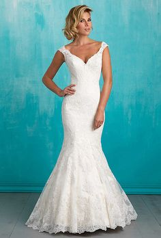 Brides: Allure Bridals. Scalloped lace makes a subtle statement in this understated yet sexy gown.
