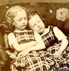 At first glance this could be any normal photograph of girls together on a sofa, but the one on the left is dead. Her sister has been dressed in an identical dress and asked to cosy up to the dead girl. She actually looks reasonably comfortable with the situation – after all, it's just her sister. You can see that a book has been used to prop up the dead girl. Such a sad photo..