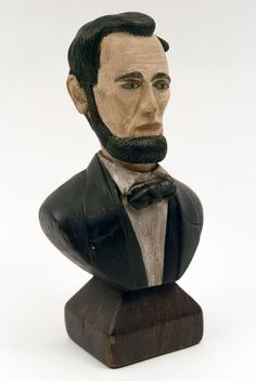 """Antique Folk Art Carving Bust of Abraham Lincoln Exquisitely carved details and subtle polychromatic paint decoration  Circa 1900-1920: Measuring 9 ½"""" tall and 5"""" wide, this exquisitely rendered and beautifully painted one piece wooden bust of President Abraham Lincoln is a prime example of the patriotic folk art created around the celebration of our 16th President's 100th birthday in 1909 when sparks of nationalistic pride ignited across the country."""