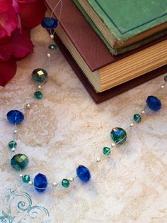 "Ever wondered what a floating bead necklace is? In this DIY jewelry-making lesson, learn how to string beads on clear wire so that they appear to ""float."""
