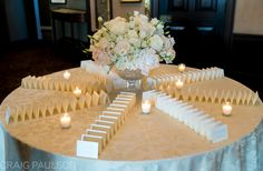 Place card table floral design by Crest Florist  Photography by Craig Paulson Photography