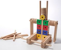 Beam and bobbin blocks: cubes, bobbins, and beams slide easily onto dowels so kids' creations can twist, turn, and roll.