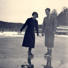 Old photo of couple ice skating.