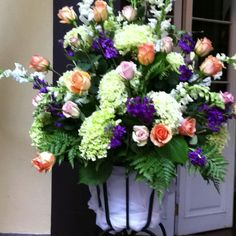 Arrangements of Hydrangea, snaps and roses at the Hotel Mazarin in New Orleans, La only outdoor courtyard with a cover if it rains.