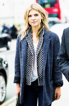 Clemence Poesy wears a pajama top, t-shirt, and blazer