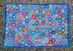African Flower Blanket: 5 months, 201 whole hexagons,  18 half hexagons