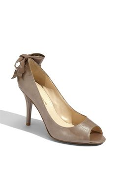 Nordstrom:  Enzo Angiolini 'Mistle' Pump  -  A patent leather bow wraps the lace-up heel of a timeless pump styled with an alluring open toe.
