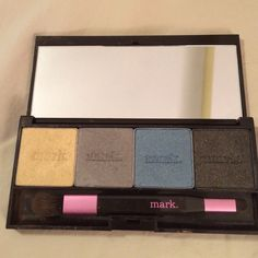 Mark brand eye shadow set 4 individual shadows with magmatic case and a double ended brush as seen in picture gently used. Excellent for smoky look. Mark / Avon Makeup Eyeshadow