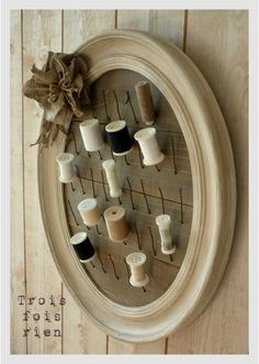 Love this spool holder!  Great idea to display a few of the 100s of bracelets my mom has.  Or any jewelry for that fact.