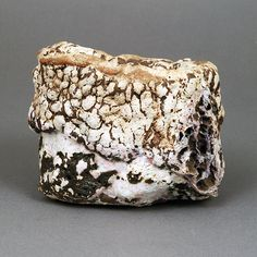 EWEN HENDERSON (British: 1934-2000) - Tea Bowl, 1990 -  Mixed laminated clays, dry volcanic surface with areas of burst bubbles in cream, brown and pink colours
