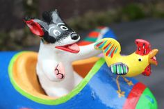 Dog, Rooster go flying in a plane! Playful Mexican folk art by Ortega Family