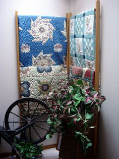 "Quilts on a ""corner"" quilt rack but would not a room or wall look devine"