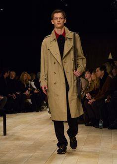 The Trench Coat, layered over a knitted polo shirt and worn with The Satchel and The Sneakers