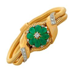 Mauboussin Lovely and feminine Retro bracelet watch created by Mauboussin in the 1940s. Features a carved emerald flower elegantly concealing the watch, accented with round diamonds.