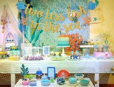 Have you ever been to an under the sea baby shower? This baby shower theme is perfect when parents to be are looking for a fun yet exciting baby shower idea. Ocean Baby Showers, Mermaid Baby Showers, Under The Sea Theme, Under The Sea Party, Baby Shower Decorations For Boys, Boy Baby Shower Themes, Wedding Decorations, Table Decorations, Dolphin Party