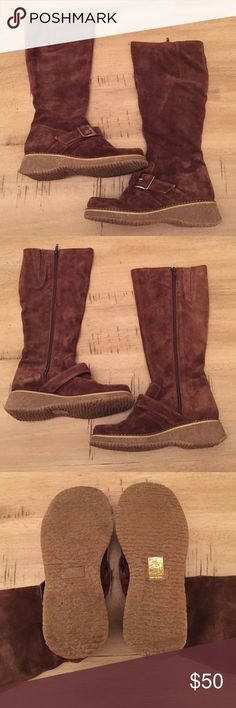 EUC Brown Suede Elle buckle boots These knee high brown suede boots are cute and comfortable, with a buckle detail over the top of the foot. New without box- only tried on, size 6, made in Italy. Elle Shoes Winter & Rain Boots